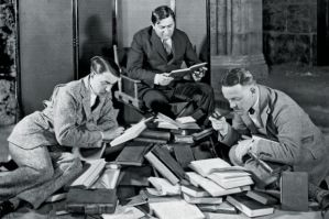 group-of-men-reading-pile-of-books